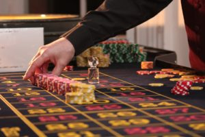 Roulette table with red and yellow chips that you can handle only if you become a good croupier