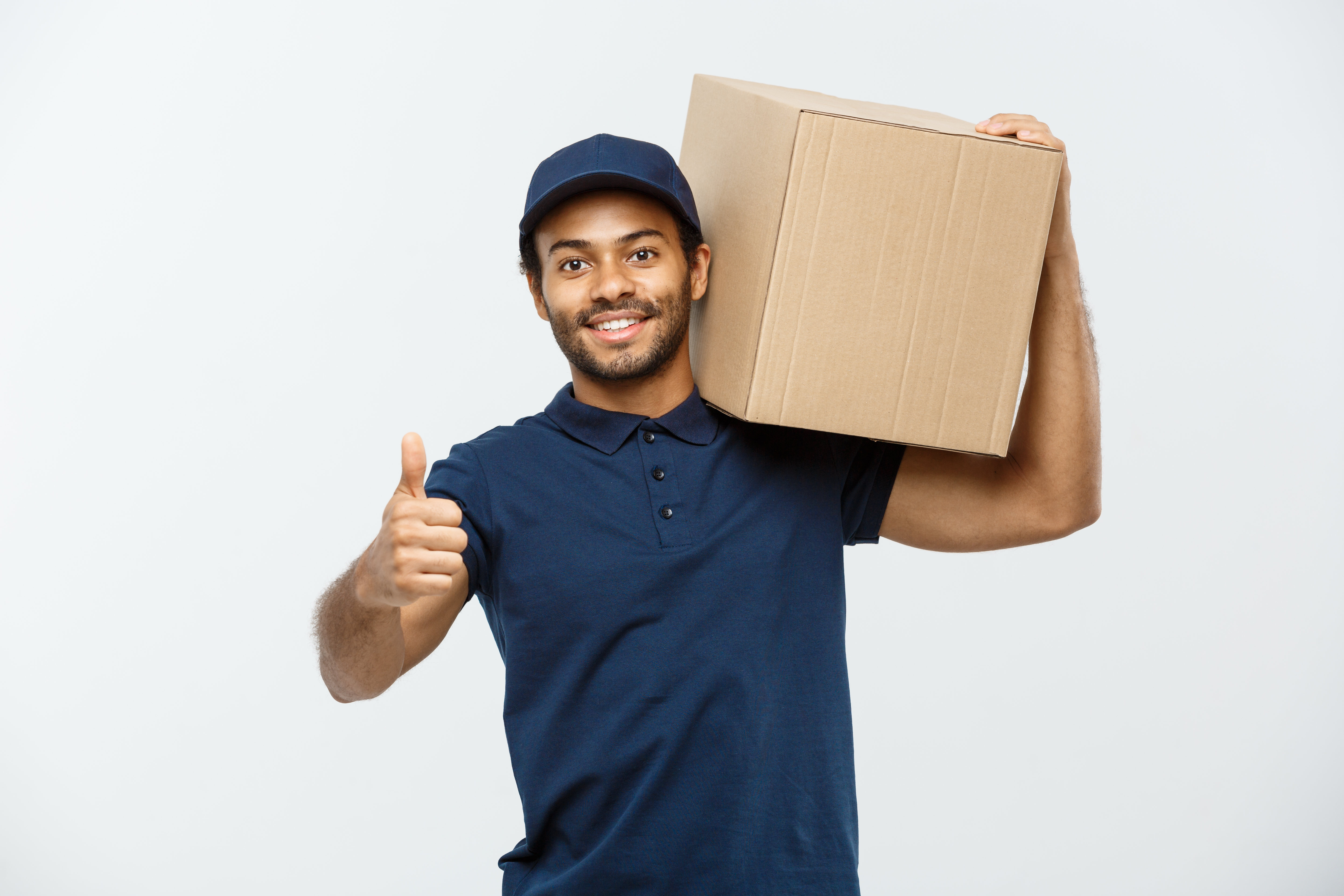 a person holding a cardboard box and showing a thumb up because of successful local moving