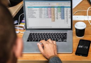 a person using Microsoft Excel to organize your moving budget properly