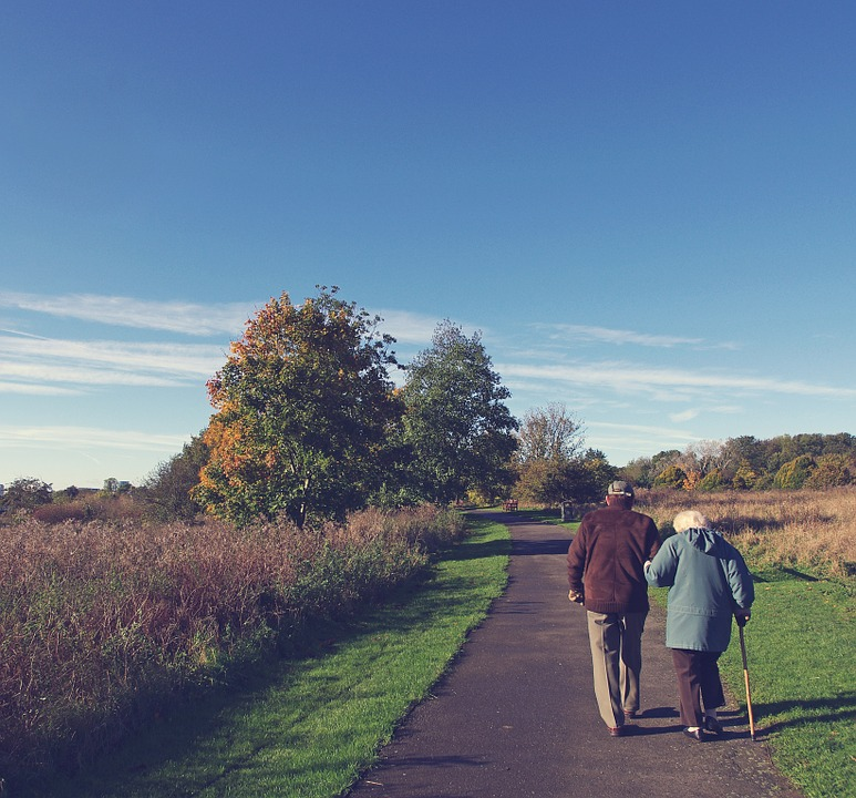 An elderly couple taking a walk and dicussing which state is better for retirement - NJ or Nevada.
