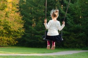 A girl swinging.