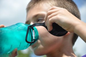 Drinking plenty of water is crucial during the hot summer months
