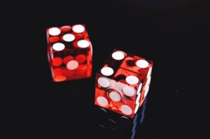 There is a close up photo of two red dices.