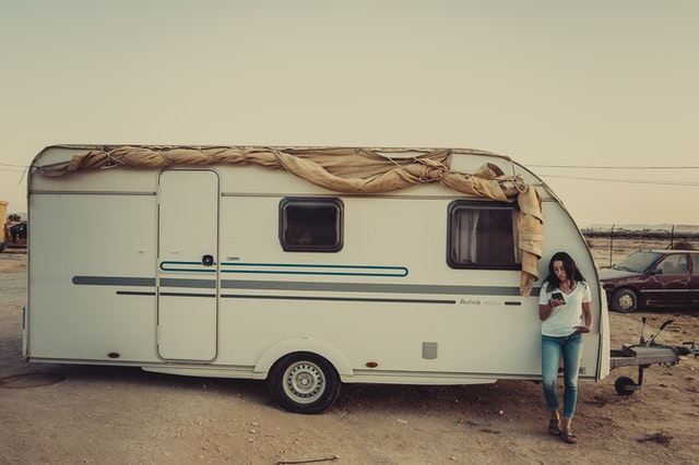 Woman leaning on an RV