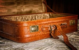 An open suitcase to pack your items after finding same day movers.