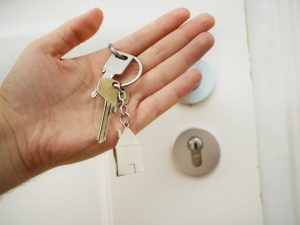 a person holding a house key after leaving Las Vegas for Maryland