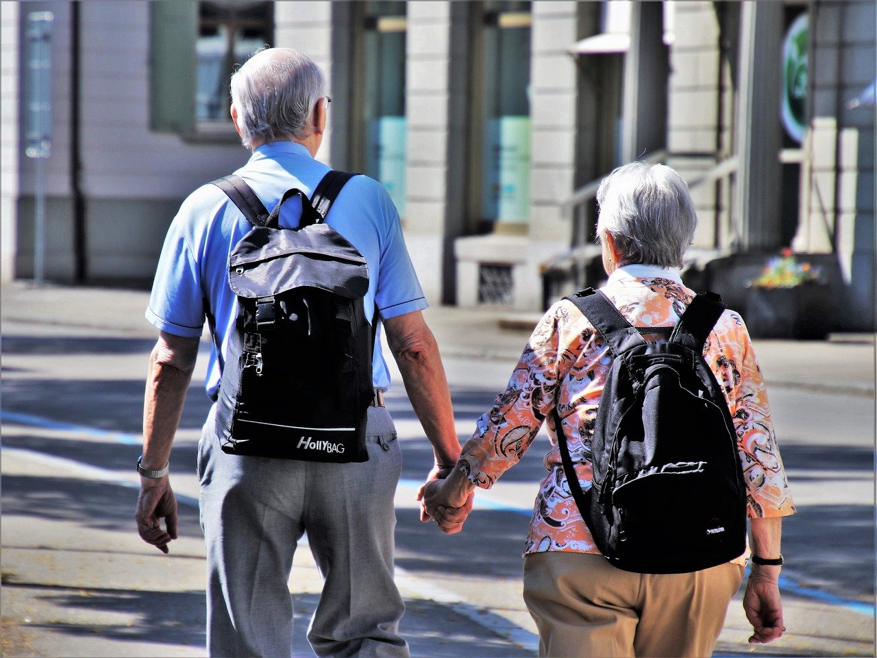 An elderly couple taking a walk after moving to one of the best NJ cities for retirees.